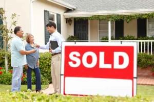 Senior Hispanic couple buying new home